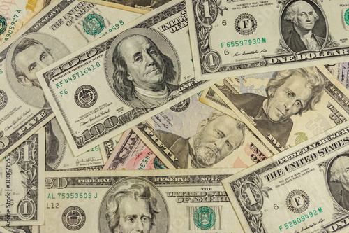 Fotomural  Background of different us dollar banknotes
