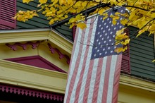 American Flag Hanging From Col...