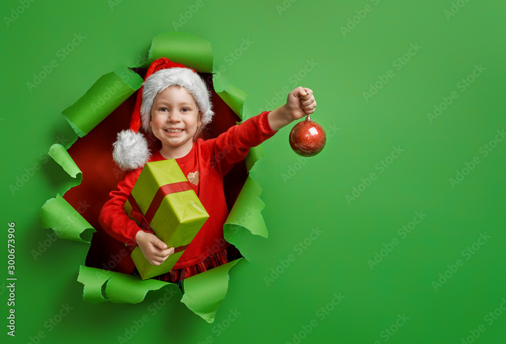 Fototapety, obrazy: girl with Christmas gift.