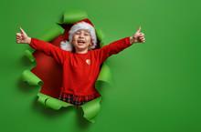 Girl In Santa Hat On Color Background