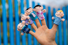 Family Finger Puppet Theater. Child Hand With Finger Puppets: Son, Daughter,mum, Dad, Granny, Granddad. Kid Playing Fingers Puppets. Family And Generation Concept.