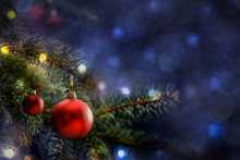 Christmas Decorations In Bright Blue Red Gold  And White Shiny And Shimmering Colors With Christmas Lights With Blurred Background.