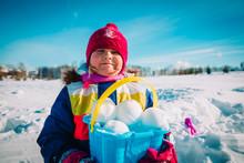 Little Girl Making Snowball In...
