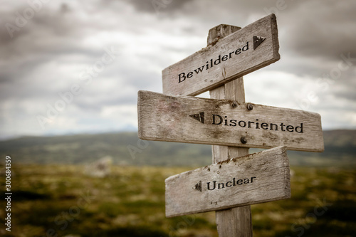 Bewildered, disoriented unclear text on wooden signpost outdoors in the wilderness Canvas-taulu
