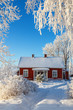 canvas print picture - Red cottage in a cold winter garden