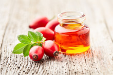 Rose Hips Oil With Berries On ...