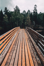 A Wooden Bridge Over A Lake In Oslo, Norway.