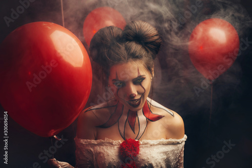 Creepy beautiful woman in the image of a scary clown Canvas Print