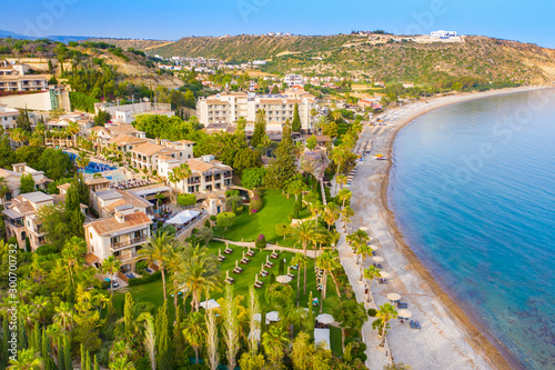 Fotobehang Cyprus Cyprus. Pissouri resort. Pissouri beach panorama from a drone. Residential settlements and hotels in the valley at the mountains bottom. The Mediterranean blue lagoon. The Travel to Cyprus.