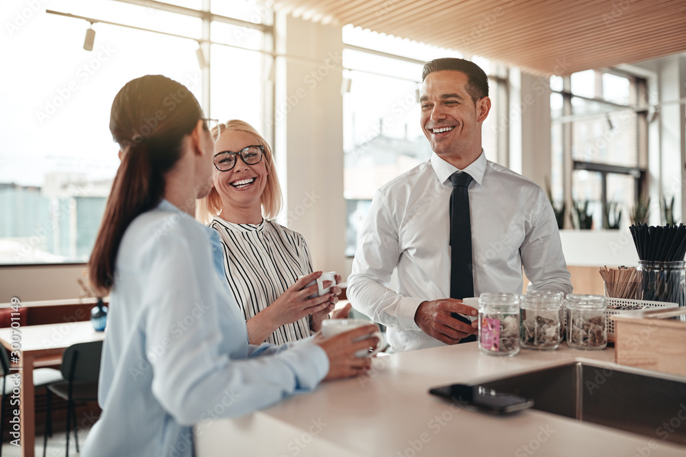 Fototapety, obrazy: Laughing businesspeople talking during their office coffee break