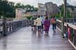 People walking on Seven Seas lagoon bridge 2