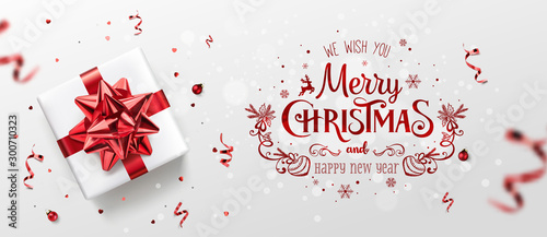 Obraz Red Christmas and New Year Text on Xmas background with gift boxes, fir branches, red ribbon, decoration, sparkles, confetti, bokeh. Merry Christmas card. Vector Illustration, realistic vector - fototapety do salonu