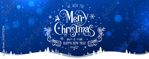 Merry Christmas and New Year text on blue background with winter landscape with snowflakes, light, stars Fototapete