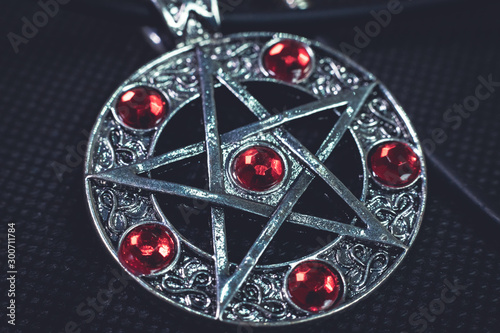Canvas Print Witch amulet, have 5 pointed star and red jewelry on it