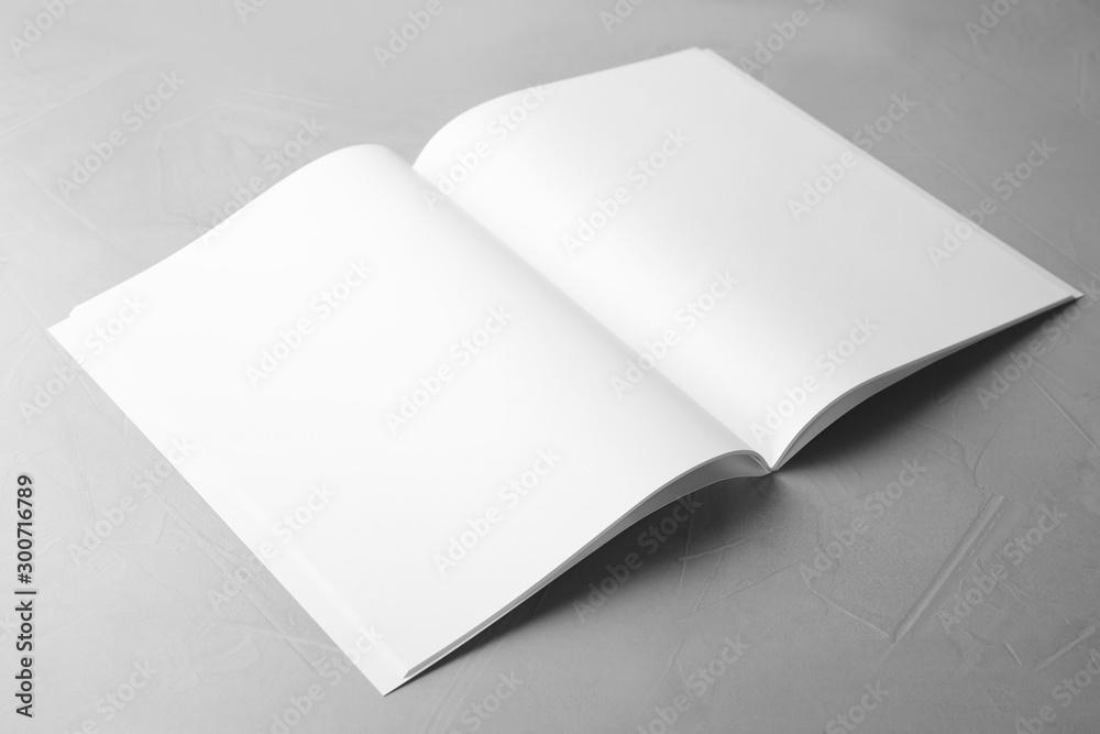 Fototapety, obrazy: Blank open book on light grey stone background. Mock up for design