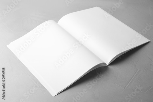 Poster Fleur Blank open book on light grey stone background. Mock up for design