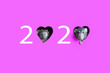 Leinwandbild Motiv The number 2020 is made of numbers and mink hearts from which rats peep. Magenta background. The rat is a symbol of 2020. Copy space. Chinese New Year.