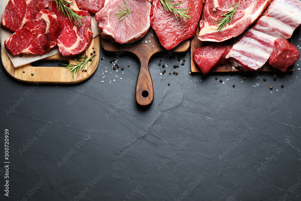 Fototapeta Flat lay composition with fresh meat on grey table. Space for text