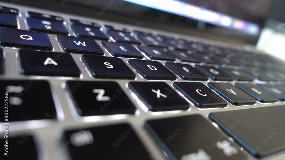 Fototapeta Photography close up shot of used laptop computer or notebook keyboard keys