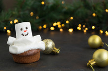 Christmas Chocolate Cupcakes With Snowman Decor. On Dark Background.