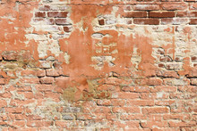 Brick Wall Pattern. Old Wall Built From The Red Bricks With Remnants Of Plaster. Background Texture.