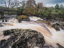 Torrent Of Water Cascading Over Linton Falls On The River Wharfe Near Grassington, Wharfedale, Yorkshire Dales, UK