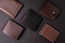 Leather Wallets On A Black Bac...