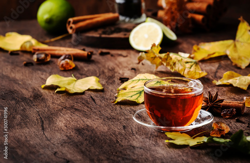 Recess Fitting Tea Autumn hot black tea in glass cup, old wooden table background, selective focus