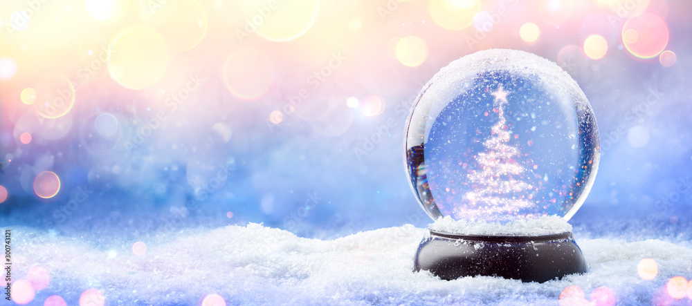 Fototapeta Shiny Christmas Tree In Snow Globe On Snow With Golden Lights