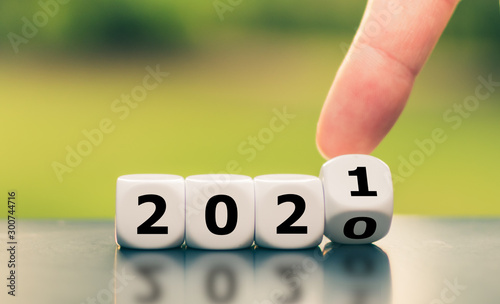 Obraz Hand turns a dice and changes the year