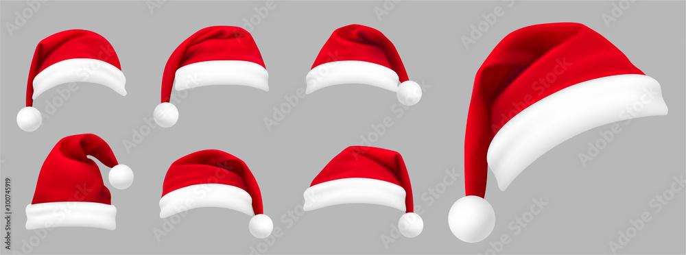Fototapeta Realistic set of red santa hats. New Year red hat. - stock vector.