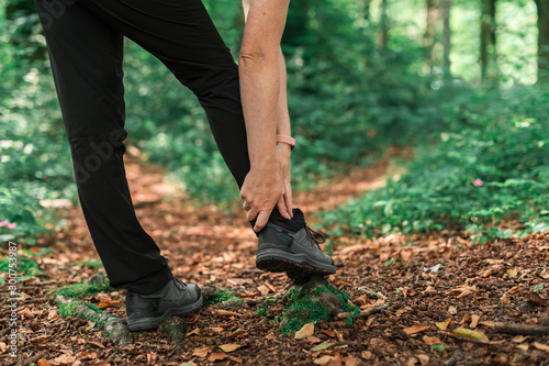 Female hiker with ankle injury in forest Canvas Print