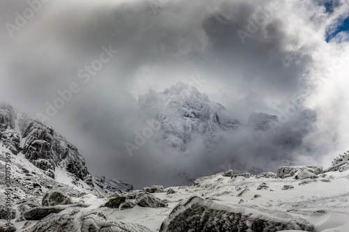 Summit in the clouds with dramatic sky at the Rila mountain in Bulgaria, Maliovica фототапет