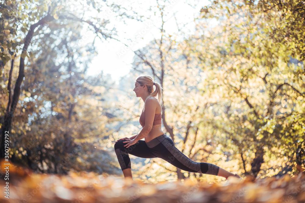Fototapety, obrazy: Woman running. Female runner jogging, training for marathon. Fit girl fitness athlete model exercising outdoor.