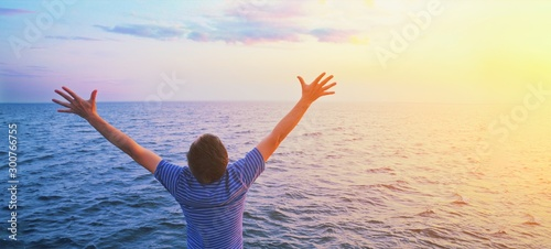 Obraz na plátně Happy prayer man with open outstretched arms