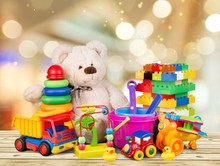 Bear And Colorful Toys On A Wo...