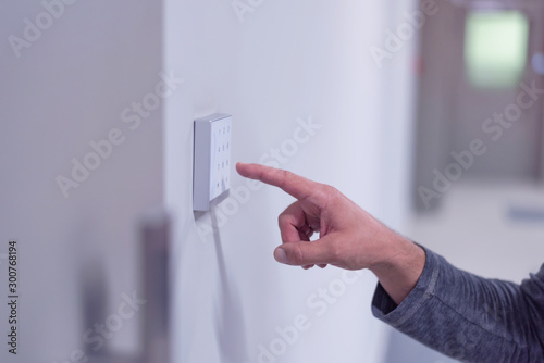 Cadres-photo bureau Macarons Young businessman entering access code at building entrance. The smart home system with access control for entering a PIN code. A hand is typing a combination on the keyboard.