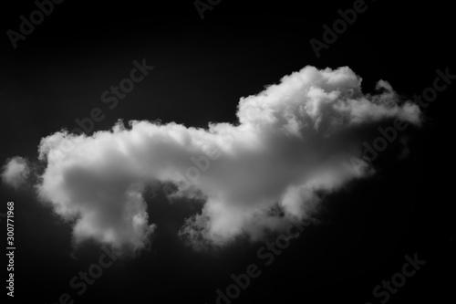 Valokuva  white cloud on black background. Dark tone.