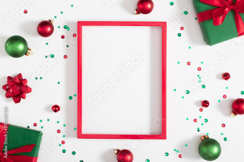 Obraz Christmas modern composition. Red photo frame, Xmas decorations on white background. Christmas, New Year, winter concept. Flat lay, top view, copy space - fototapety do salonu