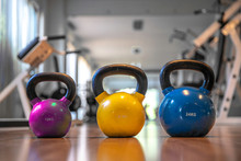 Colorful Kettlebells In A Row On Floor In A Gym, Yellow Color, Blue Color , Pink Color