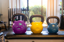 Colorful Kettlebells In A Row On Bench In A Gym, Yellow Color, Blue Color , Pink Color
