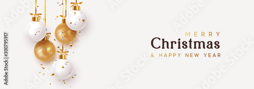 Obraz Christmas banner. Hanging white and gold Xmas decorative bauble, 3d golden metallic ball on the ribbon. Festive realistic decor. Horizontal Christmas poster, header website. vector illustration - fototapety do salonu