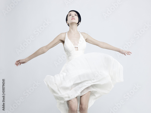 Keuken foto achterwand womenART Beautiful young lady in a billowing white dress