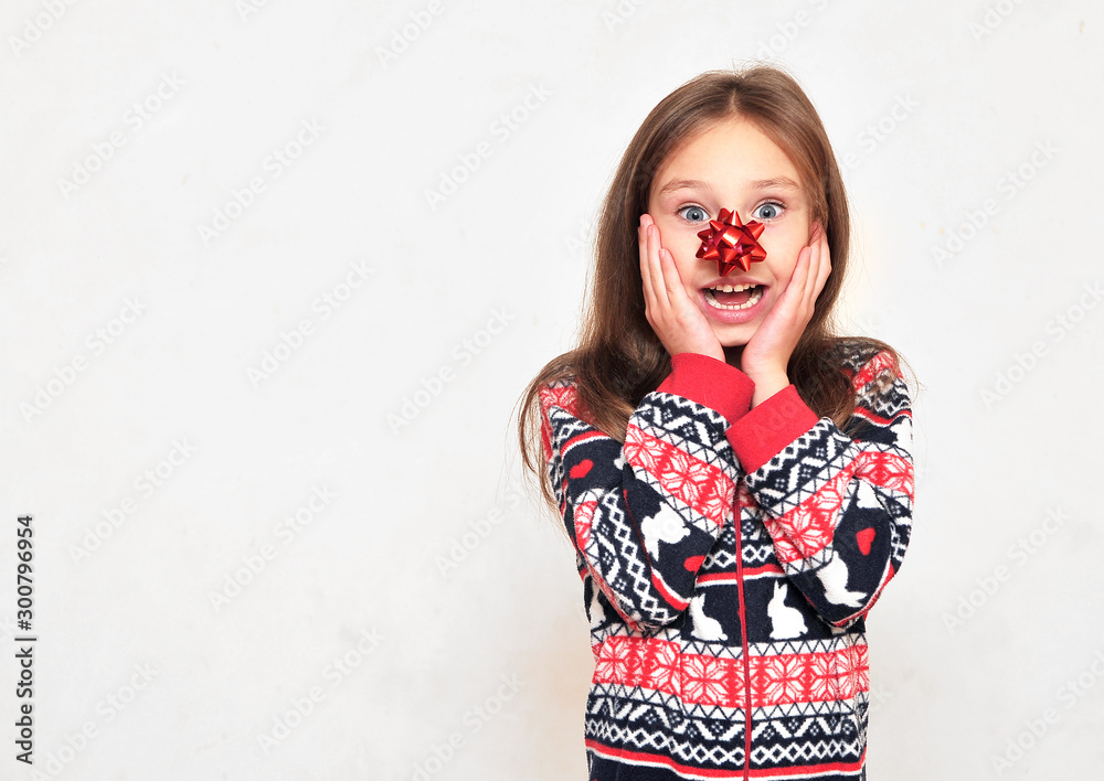 Fototapety, obrazy: Cute little girl in pajama with a bow on her nose posing on light background.