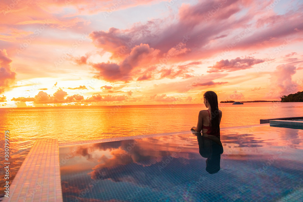 Fototapety, obrazy: Paradise sunset idyllic vacation woman silhouette swimming in infinity pool looking at sky reflections over ocean dream. Perfect amazing travel destination in Bora Bora, Tahiti, French Polynesia.