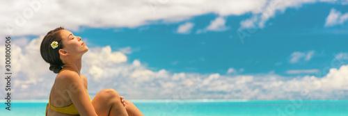 Photo Body care beauty woman in bikini touching smooth skin legs at luxury wellness spa hotel luxury resort