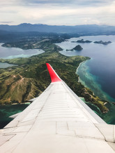 Tropical Island Coastline View From The Plane. Travel And Vacations Concept. Flores, Labuan Bajo. Indonesia
