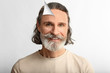 Leinwandbild Motiv Portrait of mature man on white background