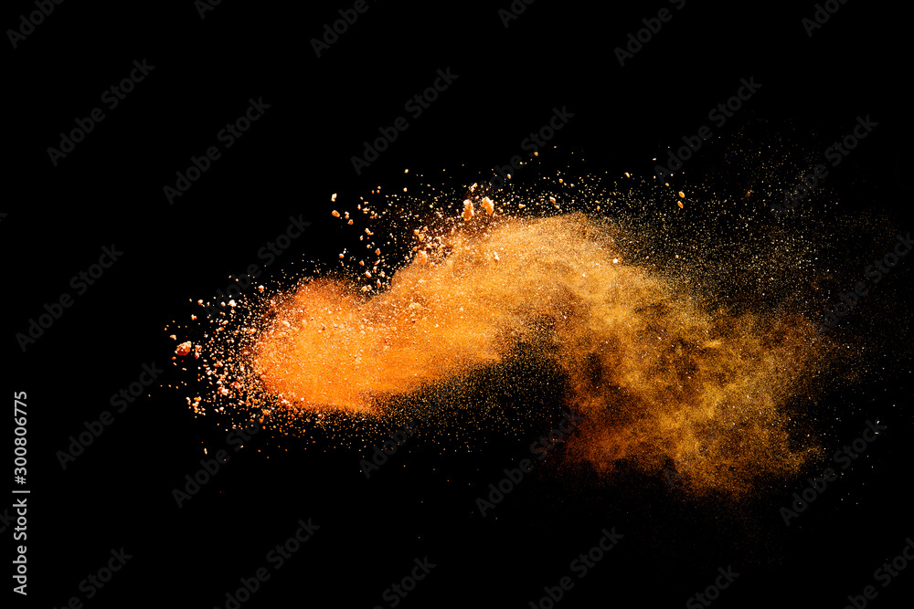 Fototapety, obrazy: Abstract orange powder explosion isolated on black background.