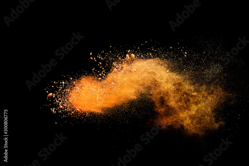 Obraz Abstract orange powder explosion isolated on black background. - fototapety do salonu